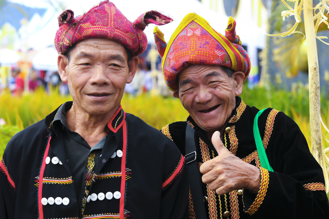 Warm smiles from the elderly while donning in their traditional costumes.